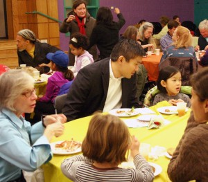 Families dine at the 2012 Thanksgiving Potluck Feast