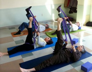 LWN yoga students do exercises
